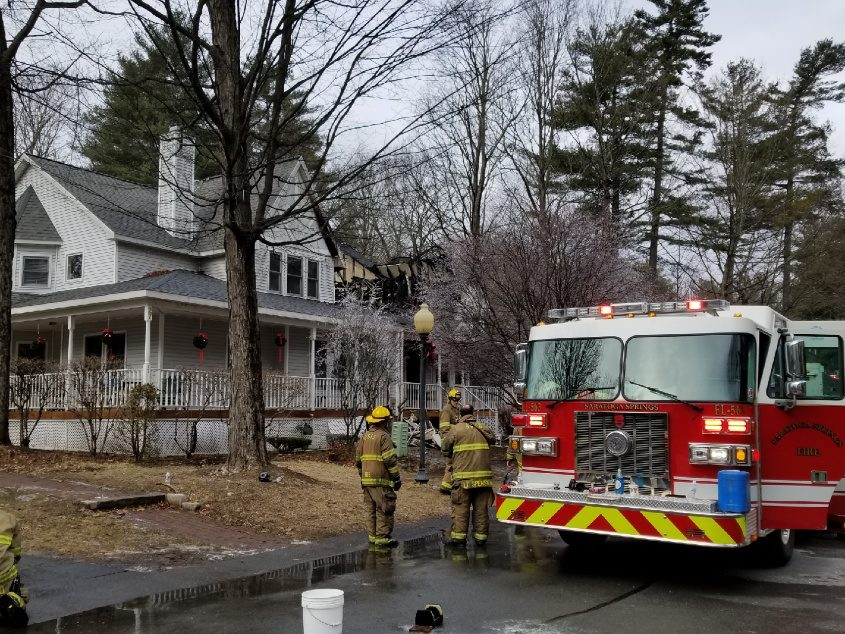 Firefighters finish up operations at the scene of a structure fire on Sarazen St. Wednesday.