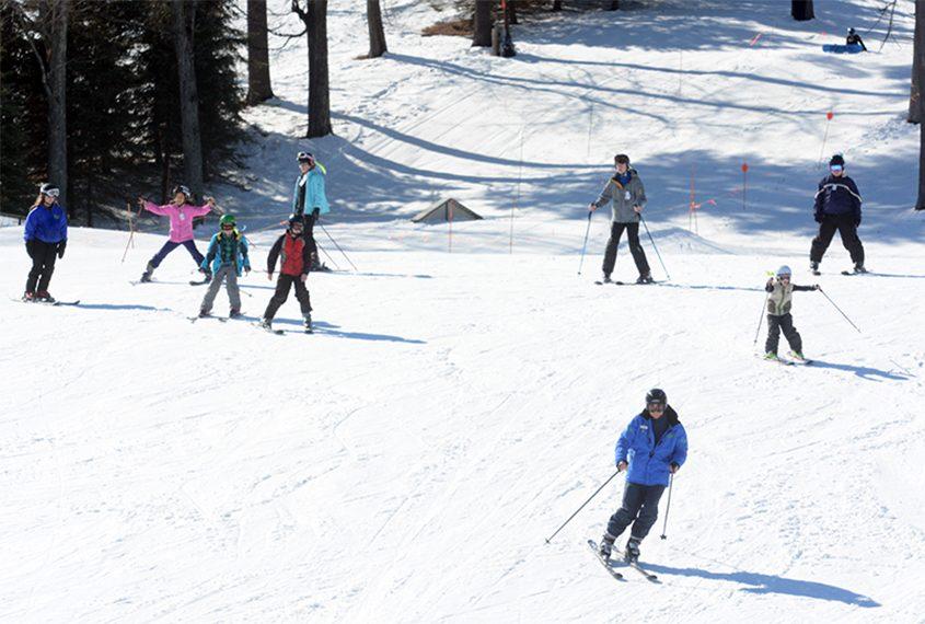 Skiers glide down a trail at Maple Ski Ridge in Rotterdam during a past ski season.