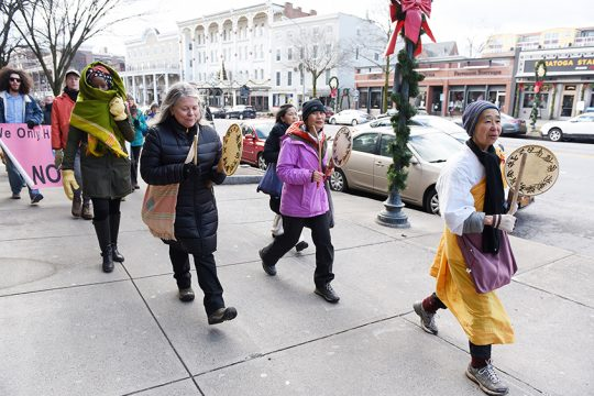 Jun-San Yasuda, who founded the Grafton Peace Pagoda, leads the New Year's Day peace walk in Saratoga Springs.