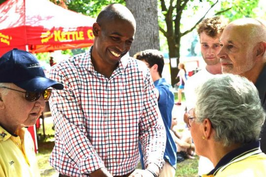 Delgado, center, talks to members of the Oneonta Rotary Club at the city's Fourth of July Fair.