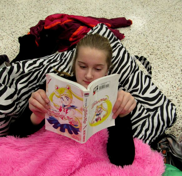 Charlotte Barberich, 11, a sixth-grader at Iroquois Middle School, reads one of her favorite books