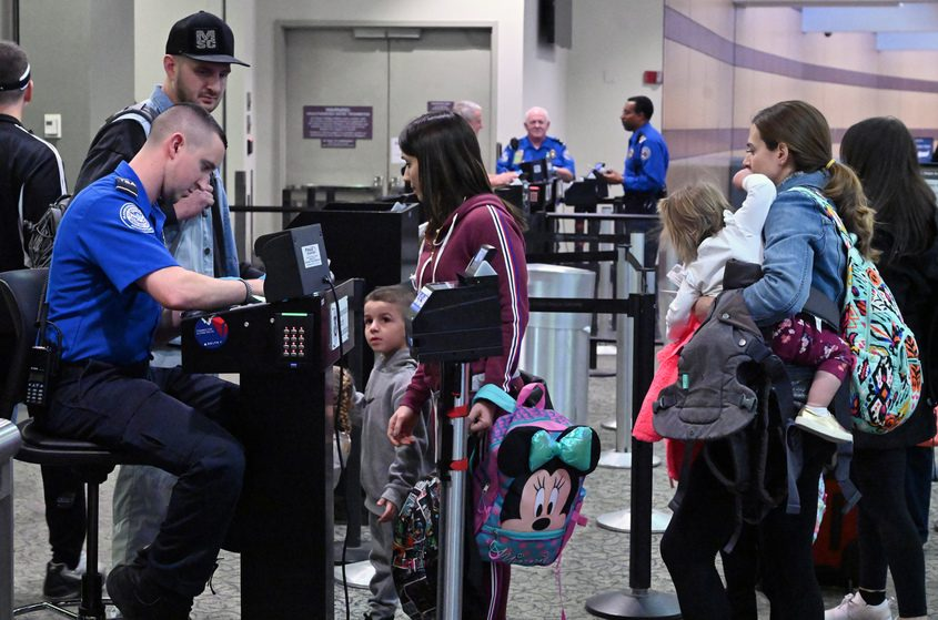 Transportation Security Administration personnel check paperwork of passengers at Albany International Airport Tuesday.