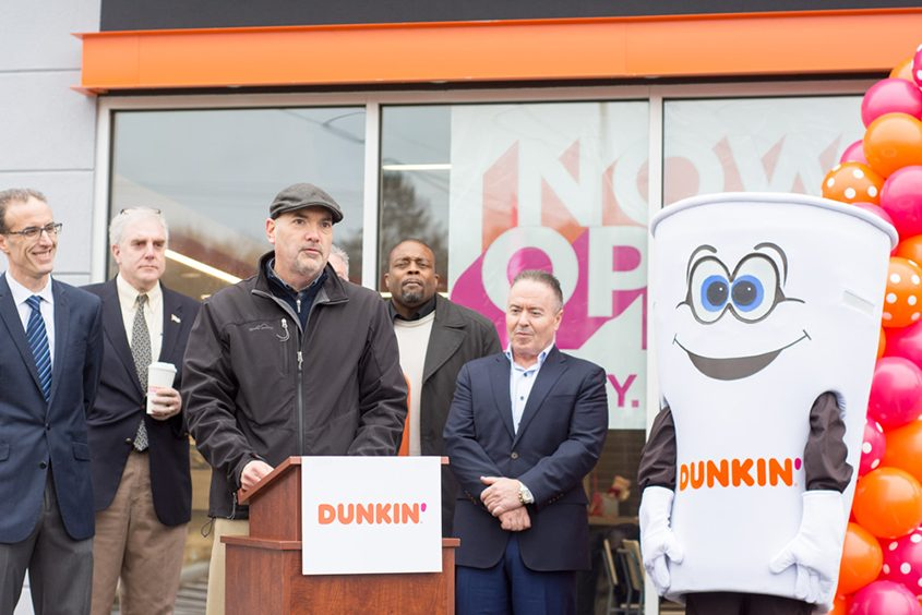 Dunkin' franchisee Kevin Wright speaks outside his new shop in Albany on Wednesday, Jan. 9, 2019.
