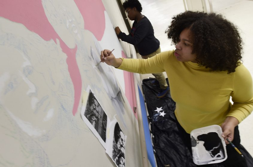Shenectady High School student and Roots Club member Ja'Deana Cognetta-Whitfield, 17, works on painting an LBGTQ mural.