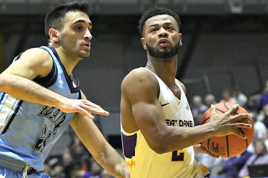 Ahmad Clark drives to the basket against Maine.
