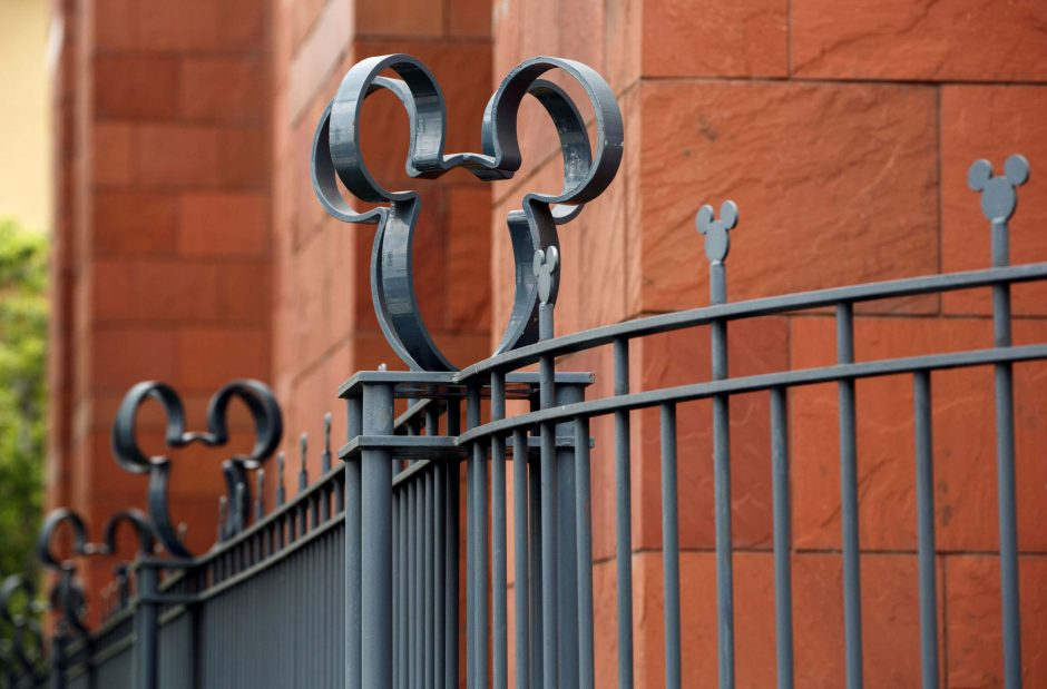The Walt Disney Co. Mickey Mouse logo on a fence at the company's studios in Burbank, Calif., on May 9, 2016.