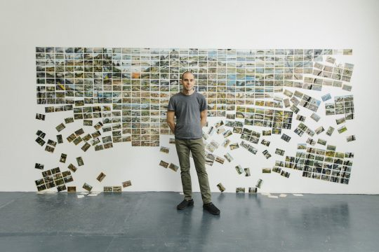 """David Opdyke with his installation, """"This Land,"""" at his studio in New York, Jan. 7, 2019."""