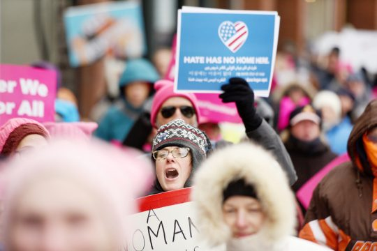 Hundreds march down Saratoga Springs' Broadway Saturday for Women's March, part of nationwide event.