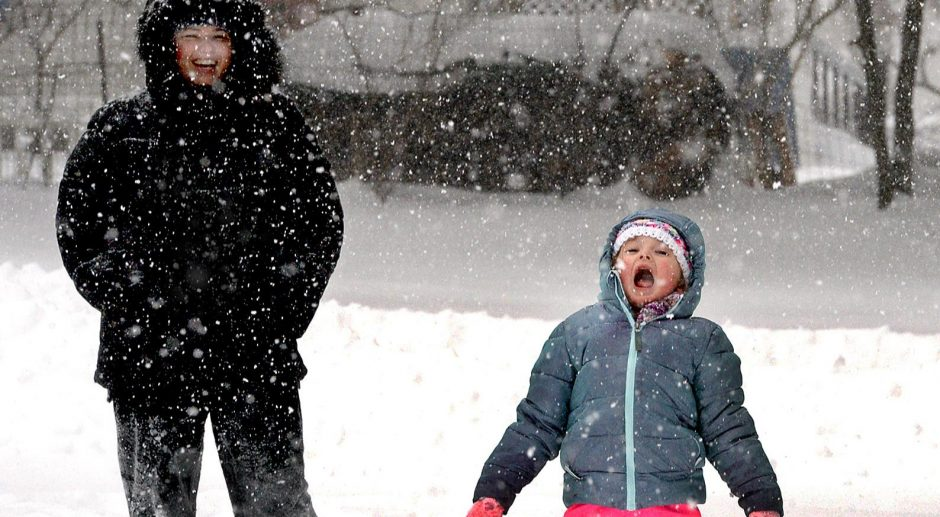 Four year old Luna DeMatteo takes a moment to stick her tongue out to catch some snowflakes during the snowstorm on Sunday.