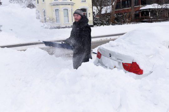 Ron Bucciero of Saratoga Springs shovels out his car on Union Avenue on Monday.