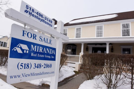 A house is for sale at the corner of Grand Ave. and Elm Street in Saratoga Springs on Saturday.
