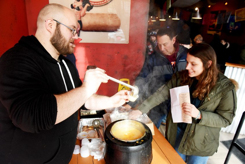 Jon Marra of Schenectady, general manager of Bombers Burrito Bar, serves Buffalo chicken soup.
