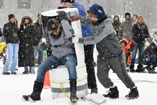 A team attempts to make its way across Lake Desolation during Sunday's Outhouse Races.