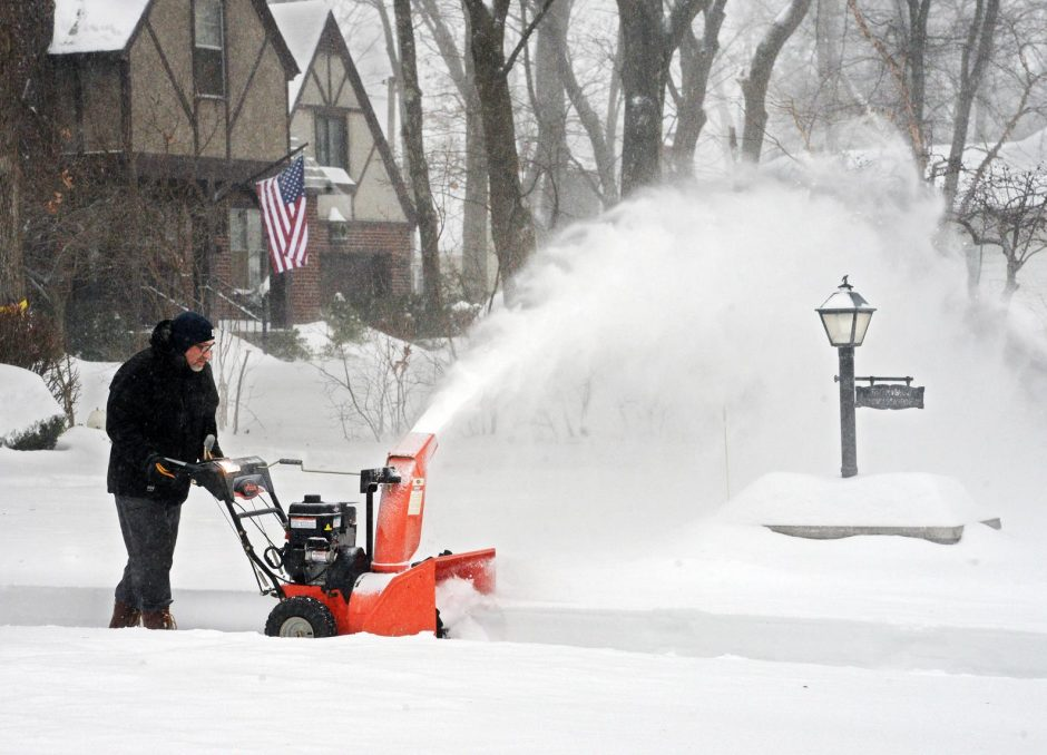 Carl Famiano of Juracka Parkway in Rotterdam clears the driveway after last weekend's storm