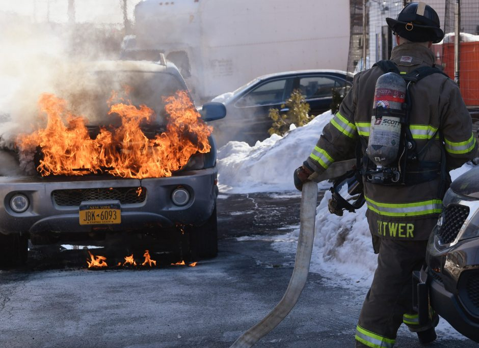 Firefighters at the scene of a car fire late Monday morning