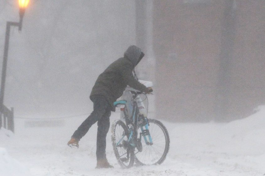 A bicyclist finds it difficult to get around in a snow storm on College Alley in Schenectady Wednesday.