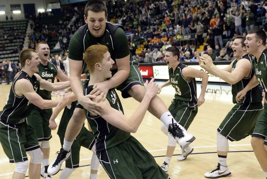 Members of the Shenendehowa boys' basketball team celebrate their 2015 state championship at Cool Insuring Arena in Glens Falls.
