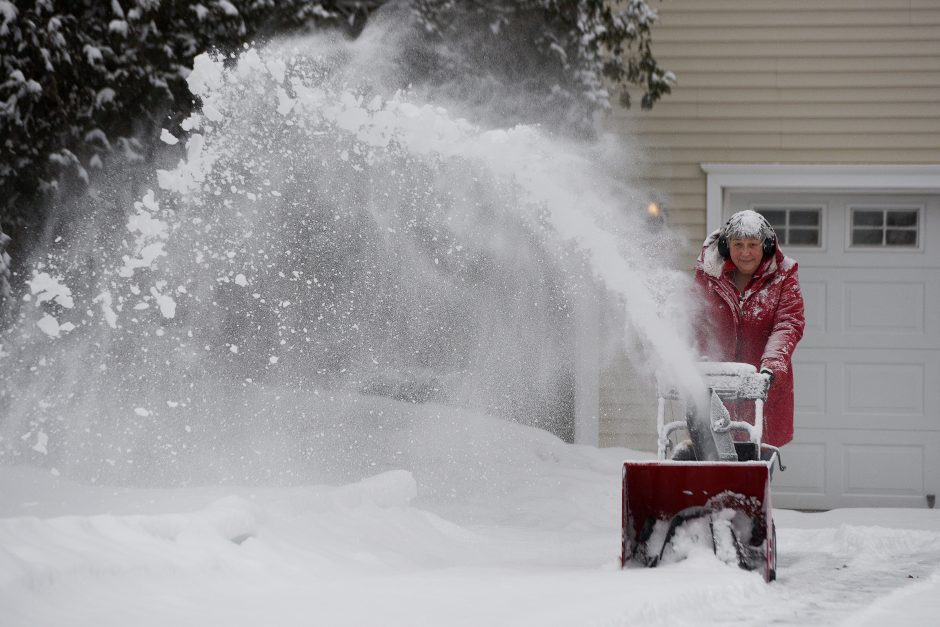 Elizabeth Collins snowplows her neighbor's driveway on Richie Place in Saratoga Springs on January 29, 2019.