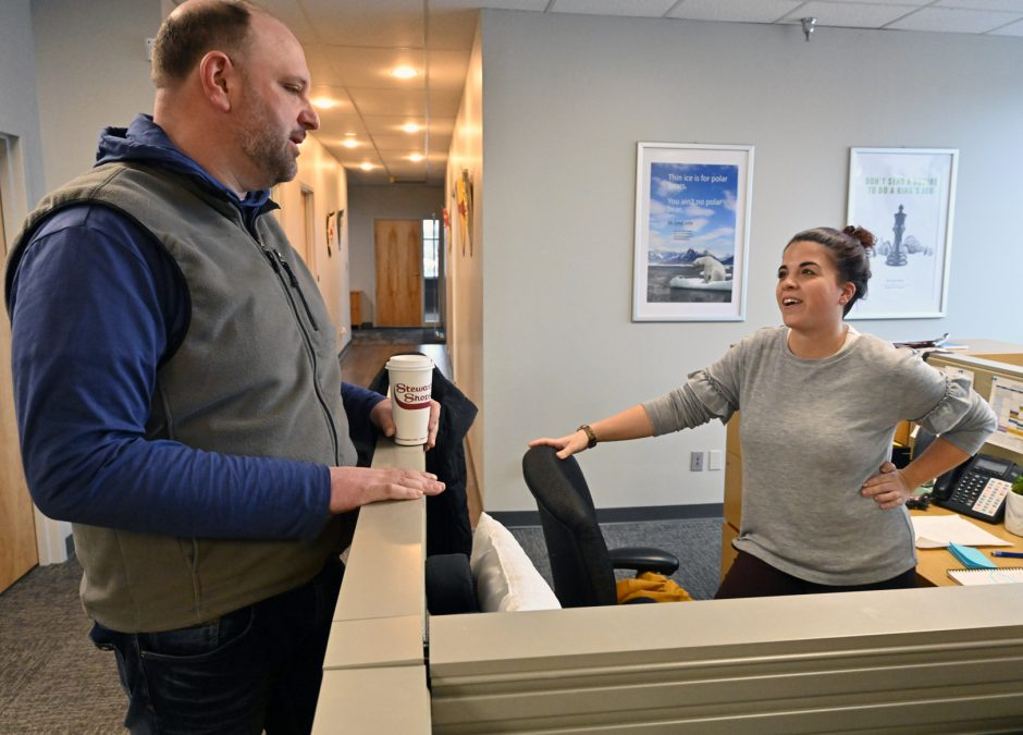 GreyCastle Security co-founder Mike Stamas, talks with one of his employees, Nina Buonarota at the company located in Troy.