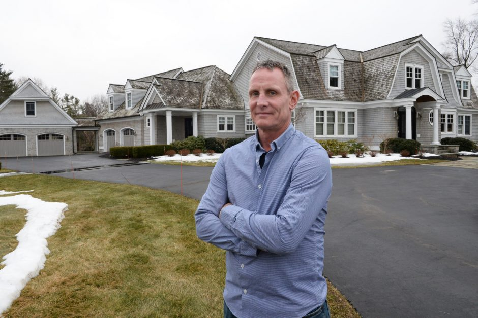 Kurt Osterlitz in front of a Niskayuna home where he has done most of the interior and exterior painting, February 8, 2019.