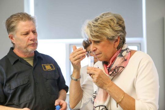 Bill Felter, owner of Serious Brewing, and SUNY Cobleskill professor Lynda McMasters-Schuyler examine a circa-1880 beer.