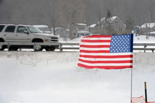 The American Flag is flying very even with the high winds along Route 159 in Mariaville on Monday morning
