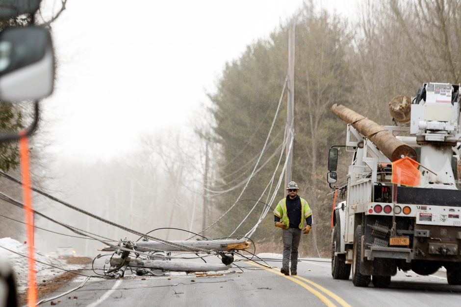 National Grid crews work on replacing a pole that snapped when a tree fell on wires in Clifton Park.