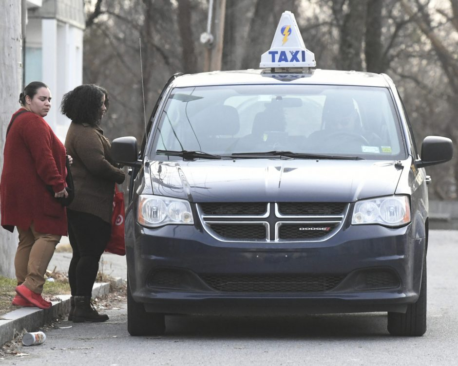 An Electric City Cab picks up a fare off Eastern Avenue in Schenectady on Jan. 2.