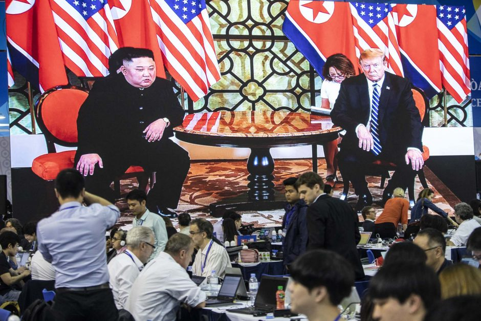 A screen shows a video of Kim Jong Un and Donald Trump as members of the media work in Hanoi, Vietnam, on Feb. 28, 2019.
