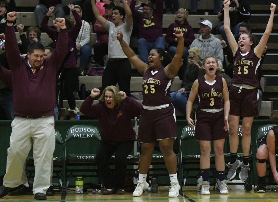 The Notre Dame-Bishop Gibbons girls' basketball team celebrates winning the Section II Class D title Friday.
