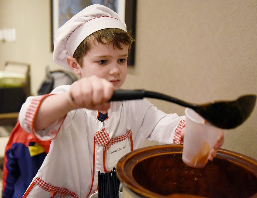 Chef Aaron Striker, 6, of Ballston Lake, serves his tomato cucumber soup for patrons during the Empty Bowls fundraiser.