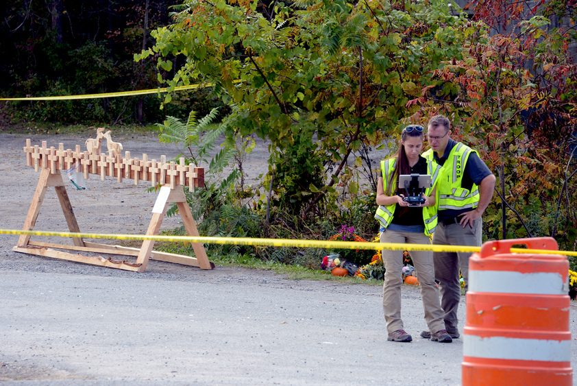 Troopers fly a drone over the Route 30 hillside where the fatal limousine crash occurred in October.