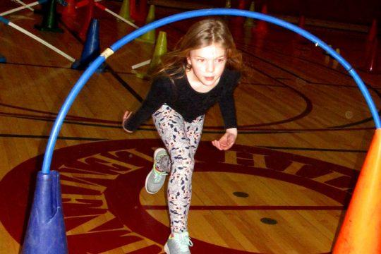 Charlie Rodgers, 8, a third-grader at Hillside Elementary School in Niskayuna, ducks under a hoops