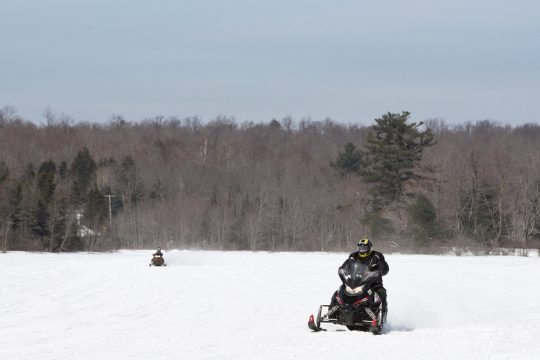 Snowmobilers ride on Lake Desolation in Middle Grove on Thursday.
