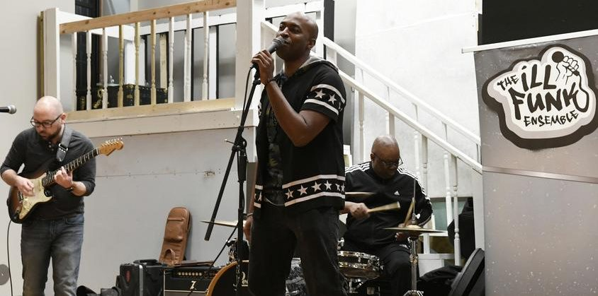The Ill Funk Ensemble performs at a benefit concert for the Carver Community Center on Saturday.