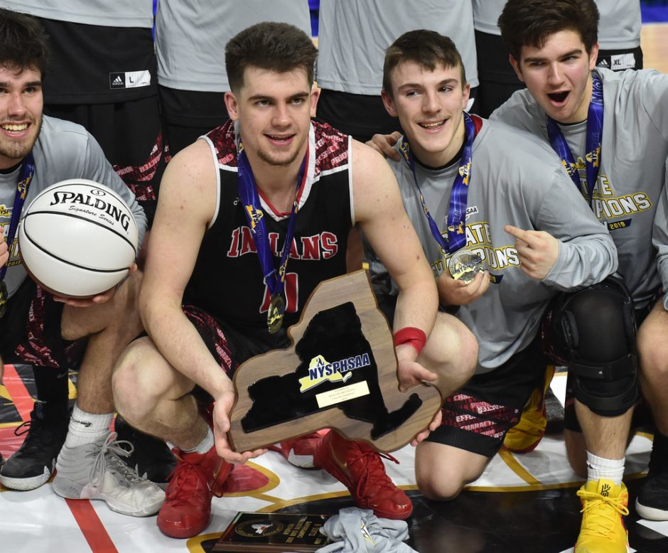 Glens Falls beat Lowville 75-74 in overtime to win the Class B state boys' basketball title Saturday.