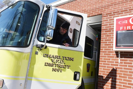 Commissioner Bob Legere shows how tight their space is for engines and firefighters at the current Charlton Fire House.