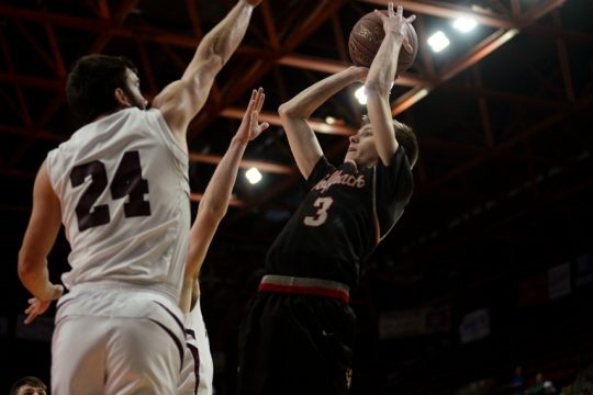 Jaedyn Logan-Dillenbeck of OESJ hoists a shot in Sunday's state Class D basketball title game against Harrisville.