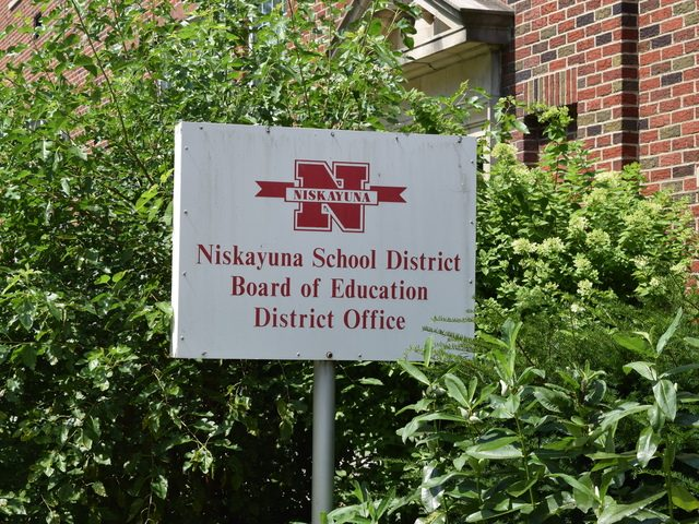 The sign at the entrance to the Niskayuna Central School District office is shown.