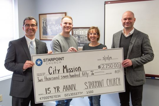 The City Mission of Schenectady receives a check for over $2,000 from Starpoint Church.