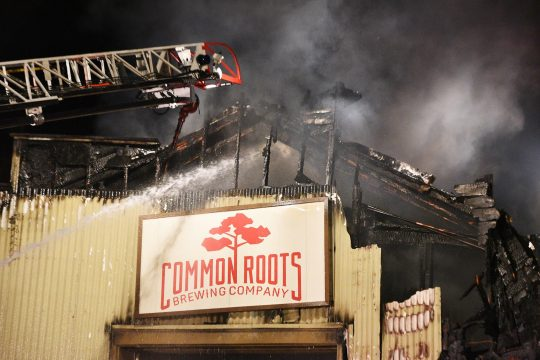 Firefighters battle the Monday night fire at Common Roots