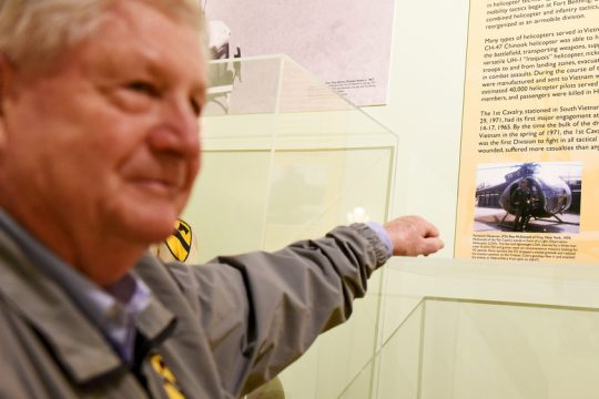 Vietnam veteran Roy McDonald of Wilton looks at a photograph of himself from 1970 on display at new exhibit.