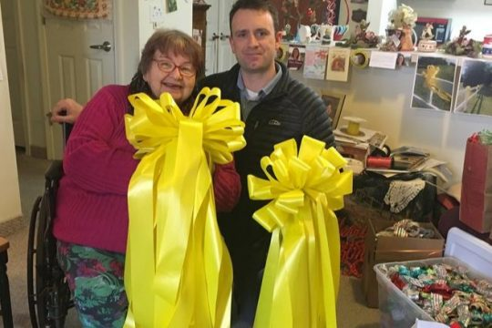 Carol Hotaling, left, with Jamie Margelot, with some of the yellow ribbons that were delivered to Fort Drum in 2018.