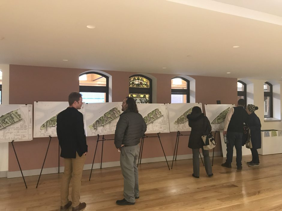 Residents view renderings of potential flood mitigation options in the Stockade neighborhood on Thursday.