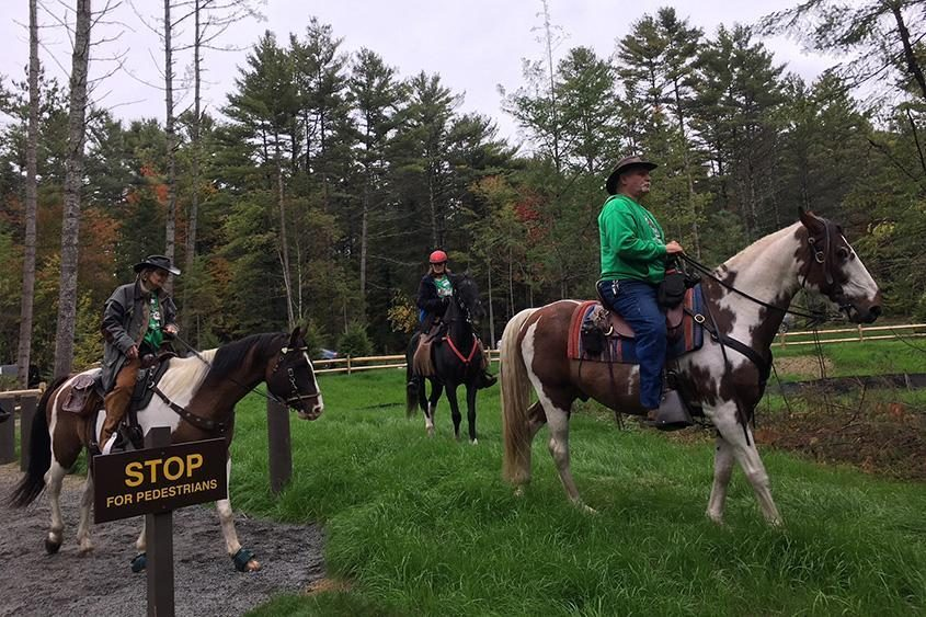 A group of horseback riders get a sneak peak at the new Frontier Town campground last year.