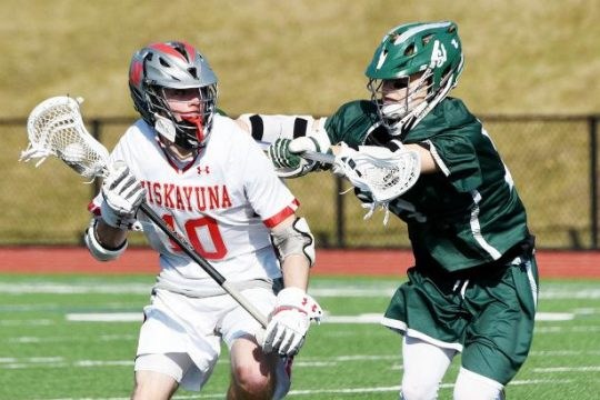 Dan Brownell of Niskayuna moves the ball while Shenendehowa's Ely Bruhns defends in a Suburban Council lacrosse game Saturday.