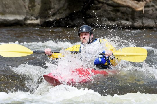 Devon Hedges guides his kayak down the Tenandeho Creek to the Hudson River during the derby on Sunday.
