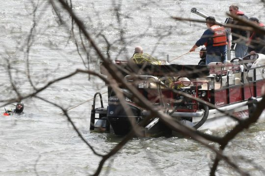 Divers work to recover the man's body Tuesday