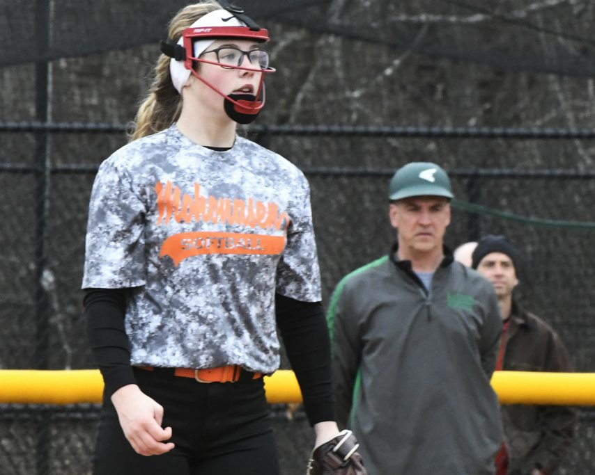 Mohonasen pitcher Matti Muller, and her dad Jeff, Schalmont's coach, watch as an out is completed in Thursday's game.