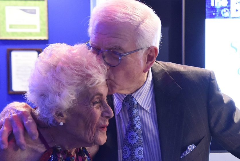 Neil Golub kisses his wife, Jane, at a miSci event on May 4.